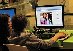 teens browsing Facebook, Internet center in Belgrade, Serbia